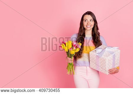 Portrait Of Attractive Cheerful Curious Girl Holding In Hands Tulips Giftbox Thinking Copy Space Sal