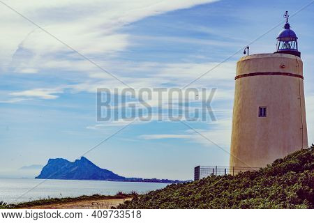 Lighthouse And Gibraltar Rock, La Alcaidesa, Spain.