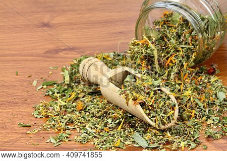 Various Dried Herbs, Alternative Medicine. Healing Herbs In A Spoon On The Brown Wooden Table, Copy