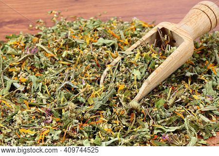 Various Dried Herbs, Alternative Medicine. Healing Herbs In A Spoon On The Brown Wooden Table.