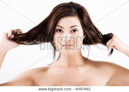 Beautiful Natural Asian Woman Pulling Hair