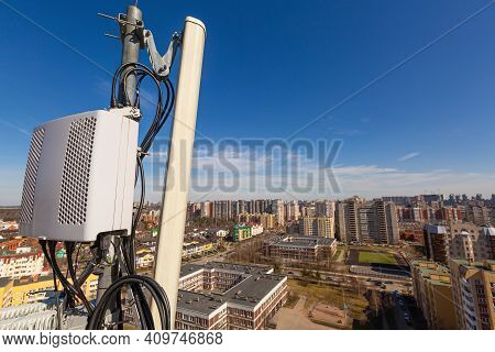 Radio Panel Antenna With Outdoor Radio Unit And Power Cables, Coaxial Cables, Optic Fibers On The Me