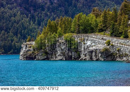 View of small alpine lake (Lago di Ceresole) in Piedmont, Northern Italy.