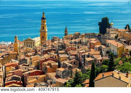View from above on old town of Menton overlooking Mediterranean sea on French Riviera.
