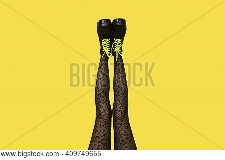 New Gray Female Boots With Bright Yellow Laces On Straight, Long Slender Woman Legs In Gray Tiger Pr