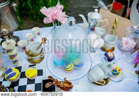 Holiday Themed Table For The Tea Ceremony. Table With Sweets. Tea With Sweets. Table Of Alice In Won