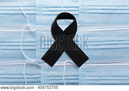 Black Mourning Tape On Medical Masks. Symbol Of Mourning And Death Of Mourning For Those Killed By T