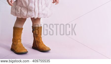 Children Boots Shoes For Little Fashionistas On A Pink Background Copyspace For Text.