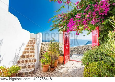 Fantastic Travel Background, Santorini Urban Landscape. Red Door Or Gate With Stairs And White Archi