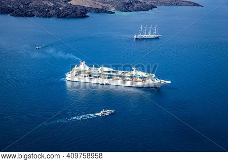 Amazing Seascape View Of Caldera In Santorini, Greece With Cruise Ships. Cloudy Dramatic Sky With Be