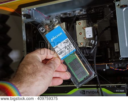 Paris, France - Feb 4, 2021: Pov Male Hand Holding Looking At The New Package Of Micron 64gb Ddr4 Rd