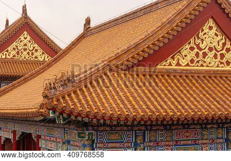 Beijing, China - April 27, 2010: Forbidden City. Roof Closeup Of Red-gold-orange Building Group On S