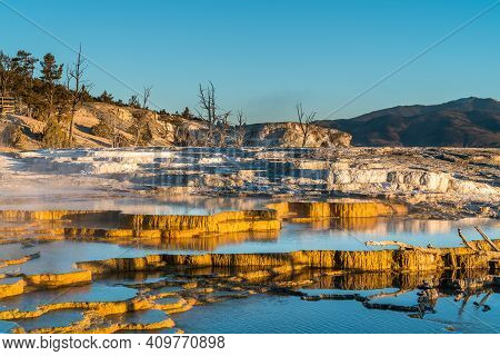 Beautiful Thermal Reflection Pools Glisten In The Morning Sun And Glow A Vibrant Golden Yellow