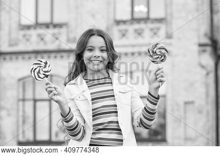 Hipster Kid With Lollipop. Her Friendly Smile. Happy Childrens Day. Small Girl Has Curly Hair. Sprin