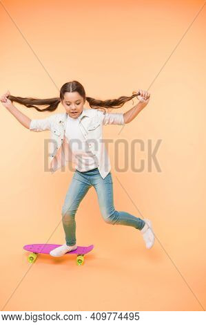 Active Leisure Concept. Kid Having Fun With Penny Board. Child Smiling Face Stand On Skateboard. Pen