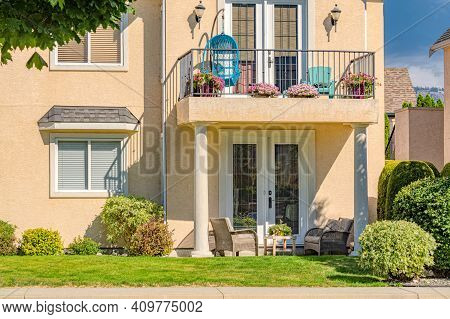 Fragment Of Luxury Residential Townhouse Facade On Bright Summer Day