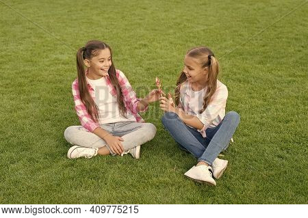 With Candy You Can Put Smile On Friends Face. Happy Friends Eat Lollipops On Green Grass. Small Frie