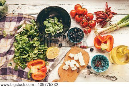 Vegetarian Low-calorie Greek Salad Preparation White Wooden Table Top View. Fresh Soft Cheese, Cherr