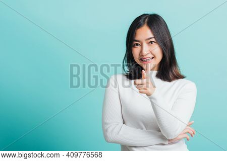 Young Beautiful Asian Woman Smiling Point Finger At You With A Confident Expression, Portrait Female