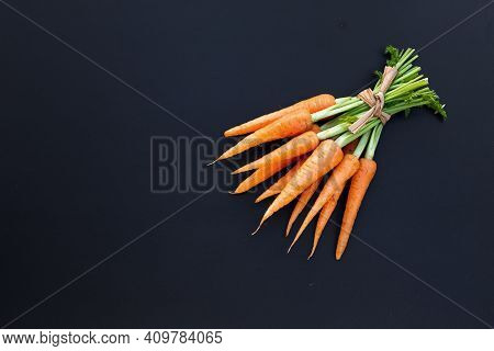 Fresh Carrots On Dark Background. Top View