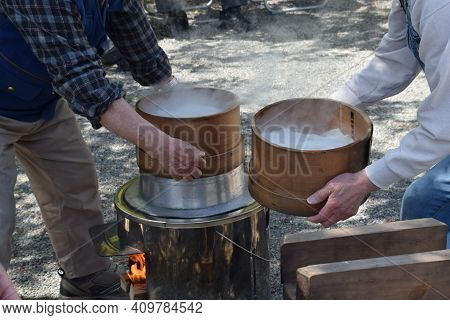 How To Make Japanese Traditional Rice Cakes (mochi-tuki) Is Many Times Pounding With A Mallet With T