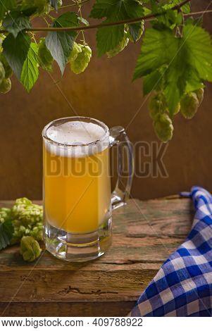 Bavarian Oktoberfest Beer And Pretzels On Wooden Table.
