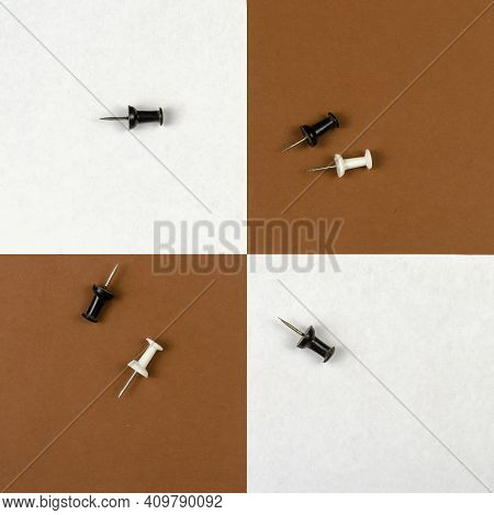 Group Of Black And White Pushpins On A Two-tone Background. White And Brown Sticky Notes Are Laid Ou