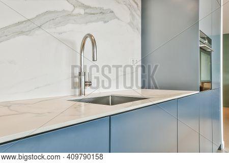 Close Up Of Sink In Luxury Kitchen