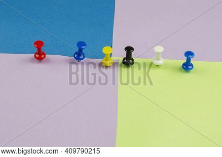 Push Pins And Lots Of Colorful Sticky Notes. Red, Blue, Yellow, Black, White Pushpins On A Multicolo