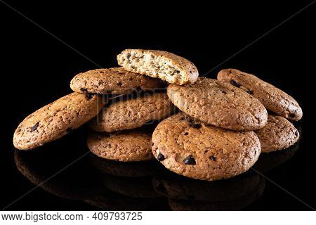 Oatmeal Cookies With Chocolate Chips Are Isolated On A Black Background With A Reflection. Lots Of B