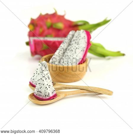 Close Up Sliced Dragon Fruits On Spoon On White