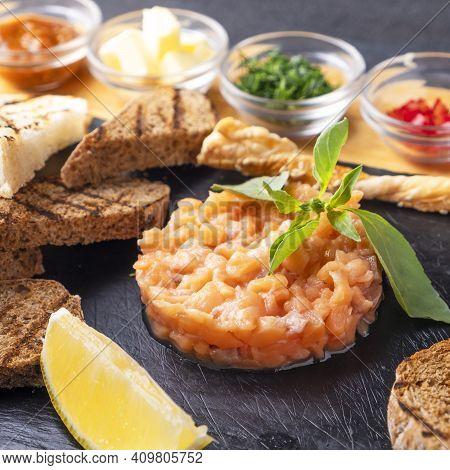 Salmon Tartare With Crispy Bread And Lemon. Raw Fish Tartare. Closeup