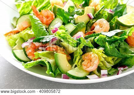 Shrimps Salad With Green Lettuce, Cucumbers And Avocado, Dressed With Lime Juice, Healthy And Tasty