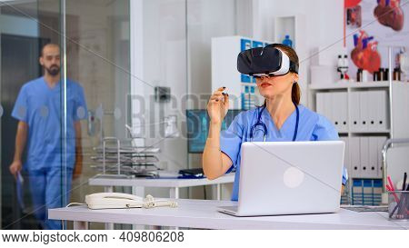 Medical Nurse Experiencing Virtual Reality Using Vr Goggles In Hospital Office. Therapist Using Medi