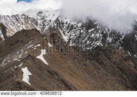 Atmospheric Minimalist Alpine Landscape To Massive Snowy Mountain Range. Firn Or Snow On Combe Rocky