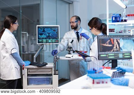 Scientists Working In Laboratory Discovering Genetic Infection Because Of Rare Disease. Chemists In