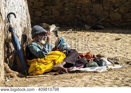 Aksum, Ethiopia - Feb 09, 2020: Orthodox Beggar At Church In The Northern Stela Park Of Aksum, Famou