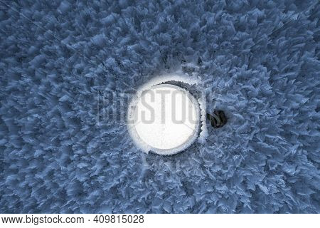 Glowing Round Lamp On Wall With Hoarfrost