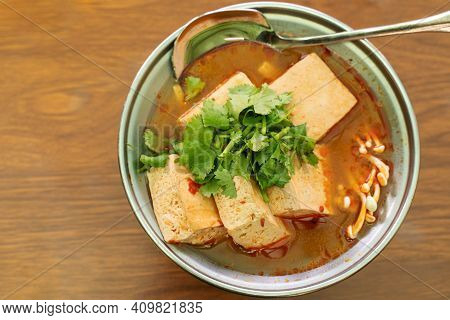 Eating Stinky Tofu Hot Pot With Spicy Soup.