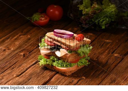 Big Double Sandwich On The Wooden Table.