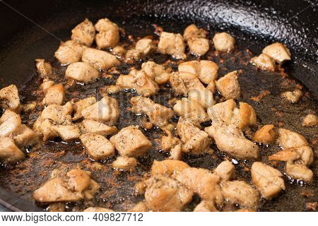 Pieces Of Chicken Fillet Are Fried In A Frying Pan In Hot Vegetable Oil. Cooking Meat.