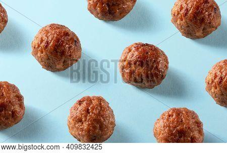 American Beef Meatballs Pattern On Blue Background. Cuisine, Menu, Recipe Backdrop. Isometric. Delic