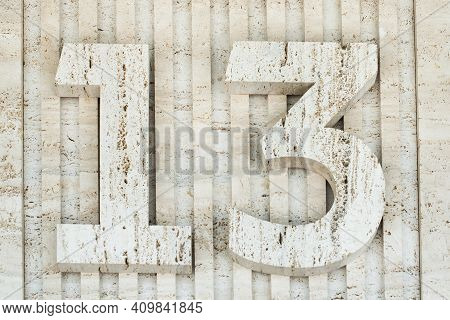Cement Number 13. Gray Stone Wall. Thirteen. Concrete Texture Background. Address, Direction, Supers