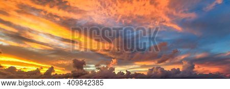 Seychelles Dramatic Sky At Sunset, Nature Background In Summer With Moving Clouds. Seychelles Island