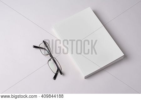 Closed Novel Book With Blank Cover On Table, Editable Mock-up Series Template Ready For Your Design,