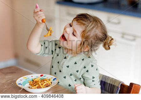 Adorable Toddler Girl Eat Pasta Macaroni Bolognese With Minced Meat. Happy Child Eating Fresh Cooked
