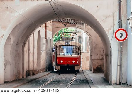Vintage Tram Tramway Between Buildings In The Streets Of Prague City