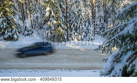 Scenic Landscape Of Winter Forest. Trees Covered By Snow. Car On Road.