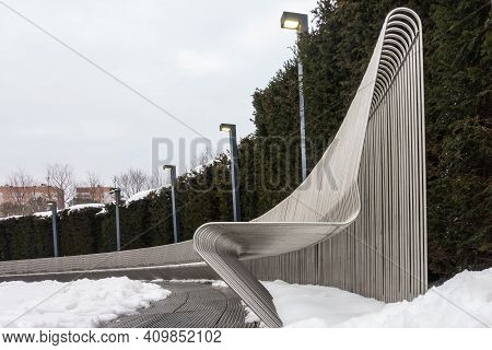 Details Of The Design Of The Park. Winter. In The Snow-covered Square, There Is A Stylized Long Curv