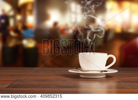 Coffee In Cup On The Table, Hot And Fresh Morning Coffee. Brown Roasted Coffee. Coffee Concept. Copy